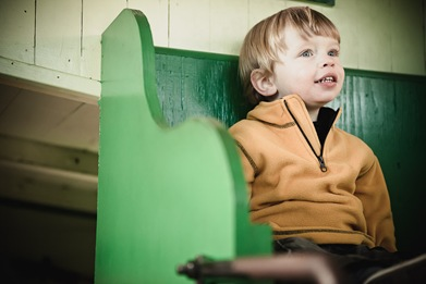 boy sitting in train car at Baltimore & Ohio Railroad Museum