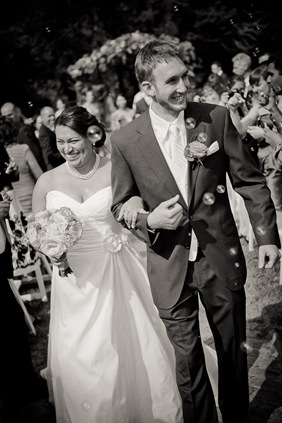 bride and groom walking down isle at Mt. Airy Mansion in Upper Marlboro Maryland