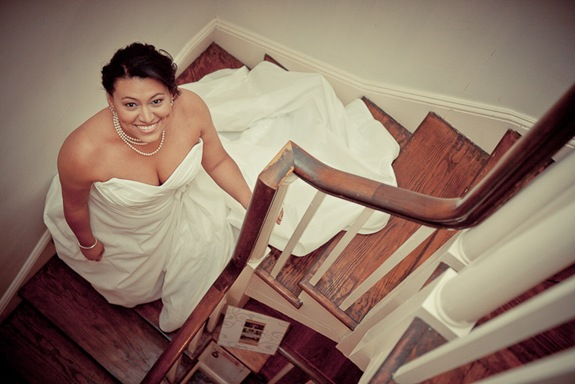 bride on stairs at Mt. Airy Mansion in Upper Marlboro Maryland