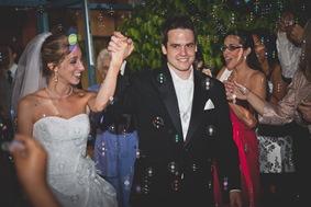 bride and groom depart the wedding