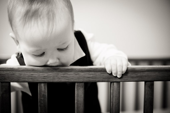 baby looking out from crib