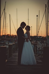 bride and groom standing in marina in Annapolis MD