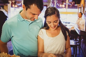 Engaged couple buying ice cream and coffee on a date
