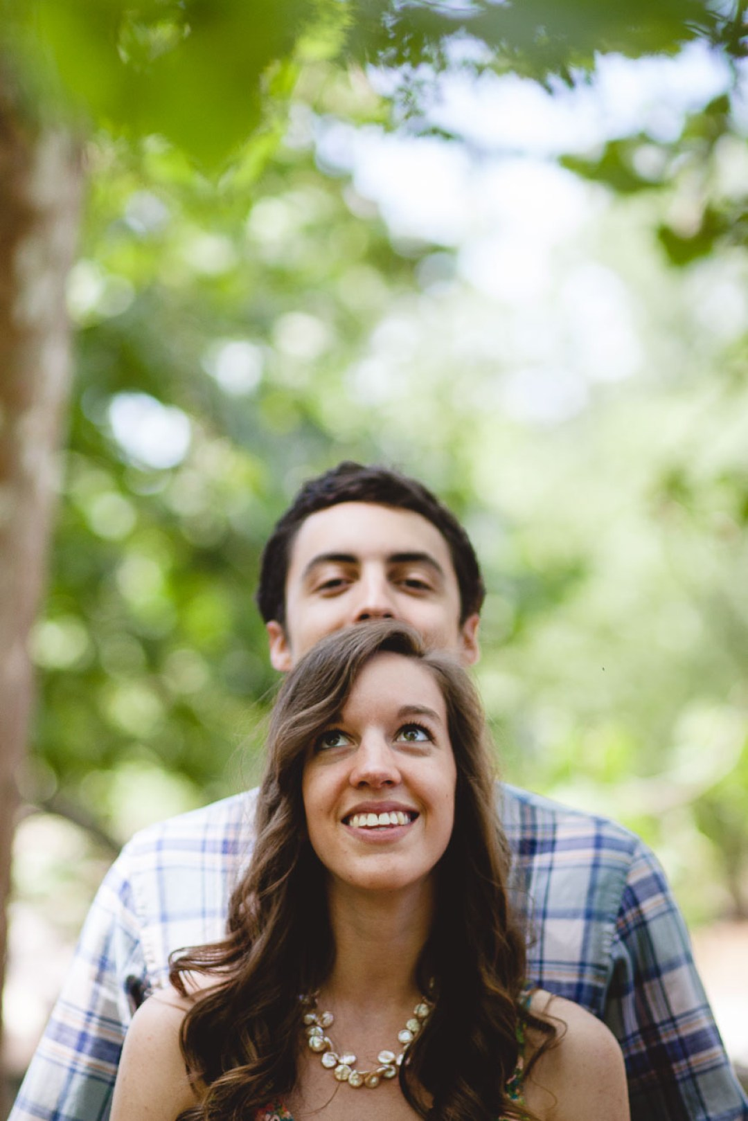 cute-couple-peaking-over-head-great-falls-maryland