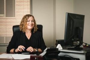 manager-sitting-at-desk-executive-portrait