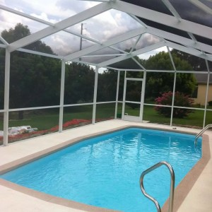 Arena 12' x 27' Pettit Fiberglass Pool with screen enclosure