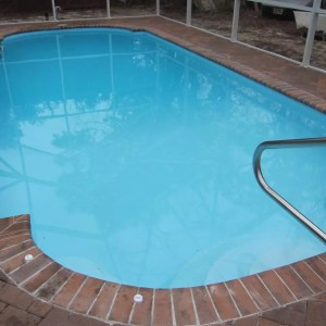 Roman 13' x 30' Pettit Fiberglass Pool with pavers