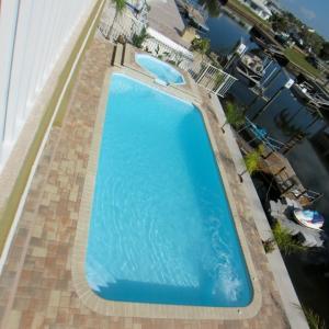 Tropical 13' x 25' Pettit Fiberglass Pool with overflow spa