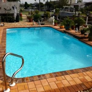 Tropical 13' x 25' Pettit Fiberglass Pool with pavers