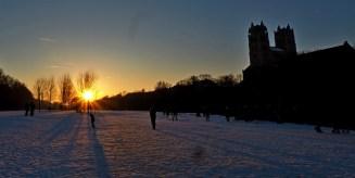 Sonnenuntergang in München unter der Reichenbachbrücke