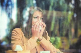 Woman Sneezing because of Allergy