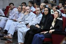 Reuters – French language teaching assistant Clotilde Reiss (R) sits next to an Iranian policewoman and other defendants …