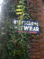 Sign on old mill building Manchester
