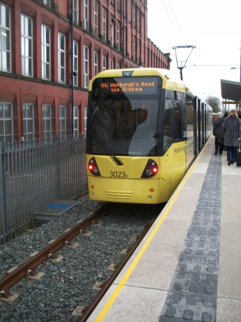 Tram at Shaw and Crompton Metrolink station, a few days after opening