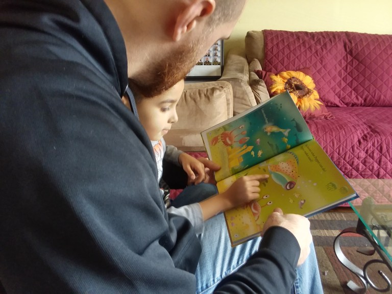 Husband Reading Pepper the Parrotfish 2 - Philly Coupon Mom