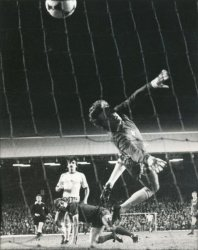 Liverpool's Kenny Dalglish scores in to the Kop end at Anfield