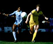 Mike Lyons and Dave Bennett do battle at Maine Road