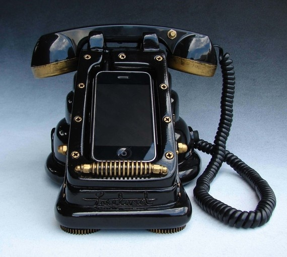 Strange steampunk-styled retro telephone hookup for an iPhone.