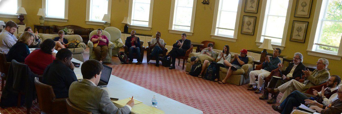 """Photo of a SOPHIA symposium at the University of Mississippi in 2013, on the topic """"Should Everyone Go to College?"""" Photo by Phillip Waller, copyright Eric Weber 2013."""