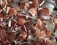 A bunch of broken ceramic pieces.