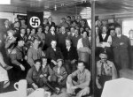 Hitler with Nazi Party members in 1930.