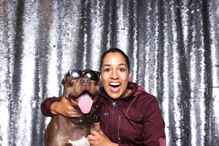 A smiley girl and her big smiley dog in the Culver City Photo Booth