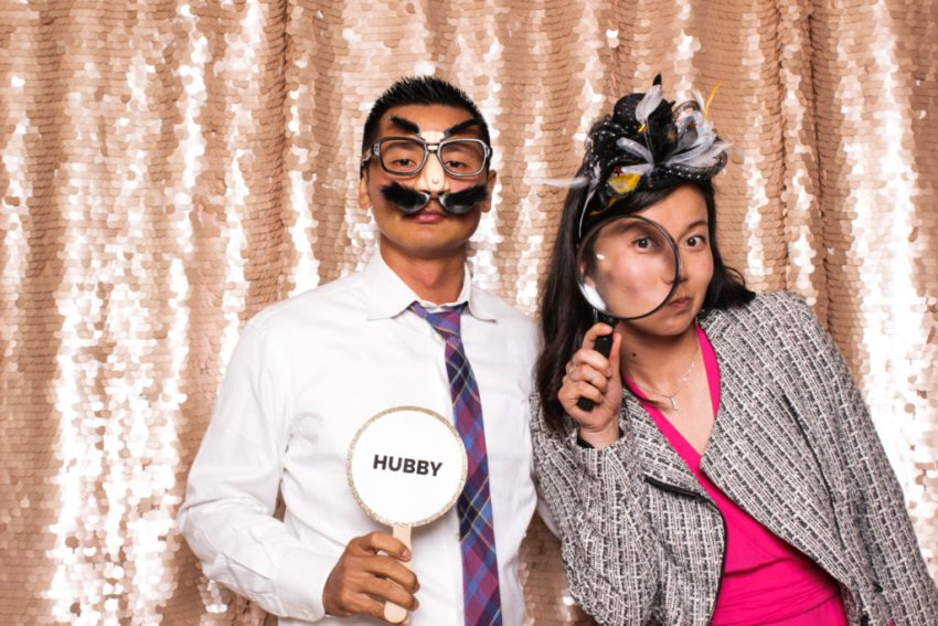 A couple enjoying the props in the Rancho Palos Verde Photo Booth