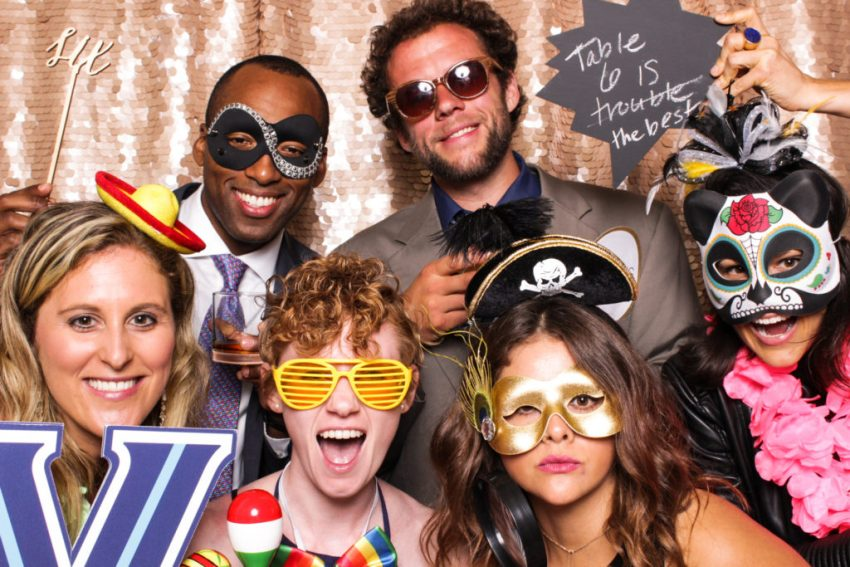 A group of friends dressed up in the Rancho Palos Verde Photo Booth