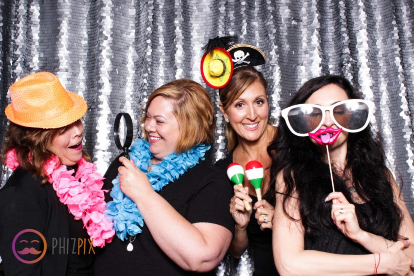 a group of friends having fun in the photo booth