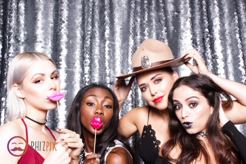 A group of beautiful girls enjoying the photo booth