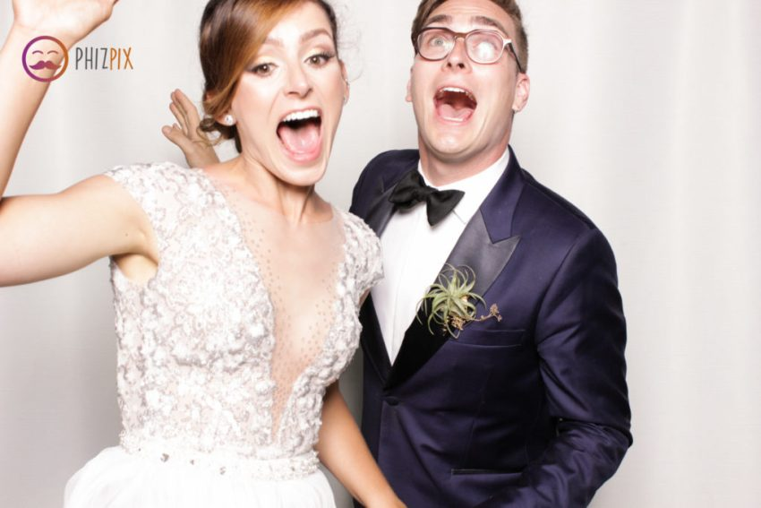 Bride and groom jumping for joy in the Malibu photo booth