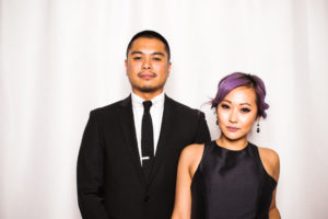 A couple posing in the photo booth