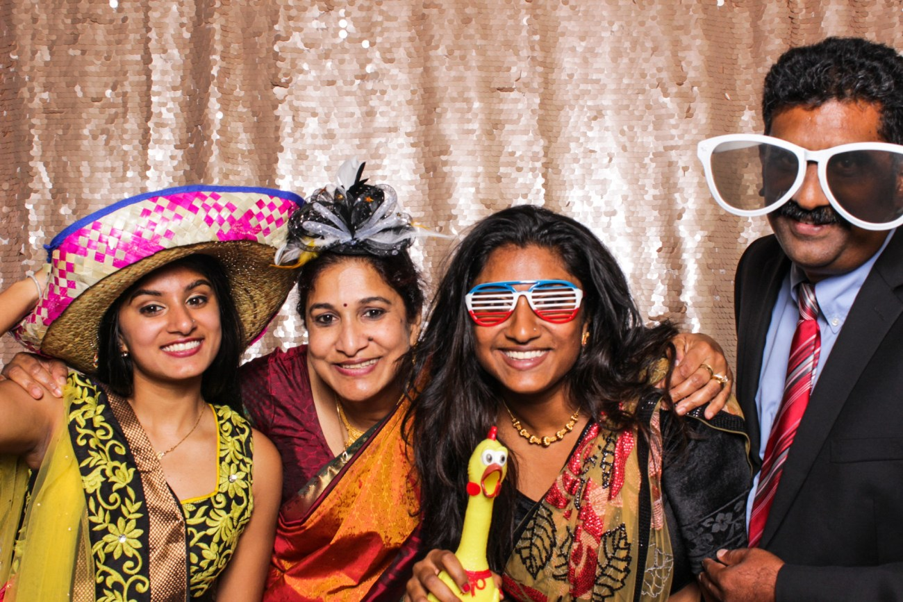 Wedding guests having fun with props in the pasadena photo booth