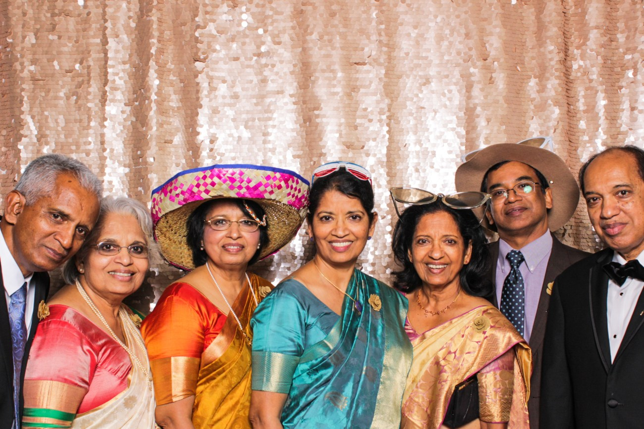 A group of wedding guests in beautiful saris posing in the pasadena photo booth