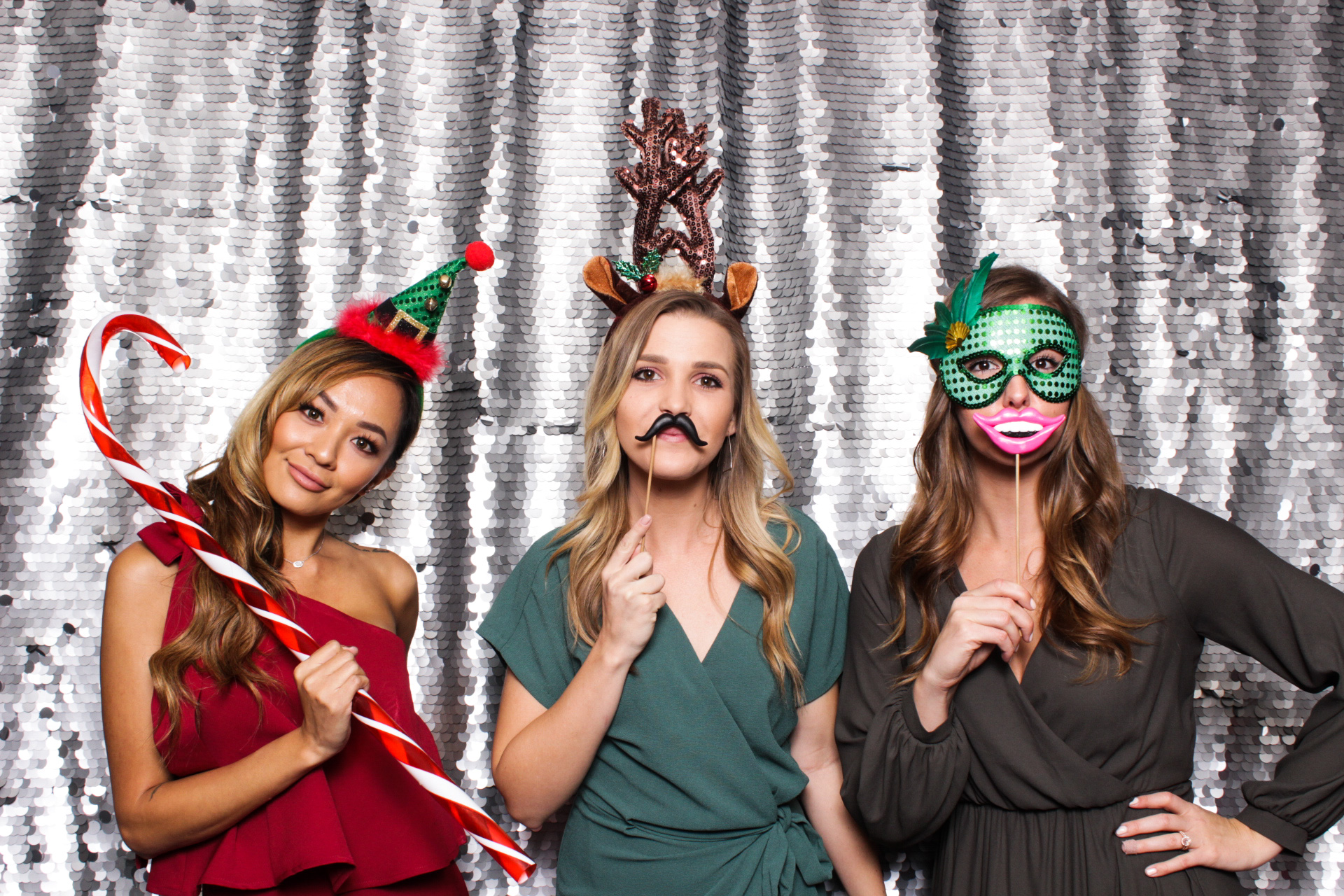 Three female friends posing wearing holiday themed costume