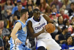 LAS VEGAS, NV - OCTOBER 18:  Ekpe Udoh #13 of the Los Angeles Clippers drives against Jusuf Nurkic #23 of the Denver Nuggets during their preseason game at the Mandalay Bay Events Center on October 18, 2014 in Las Vegas, Nevada. Denver won 104-93. NOTE TO USER: User expressly acknowledges and agrees that, by downloading and or using this photograph, User is consenting to the terms and conditions of the Getty Images License Agreement.  (Photo by Ethan Miller/Getty Images)