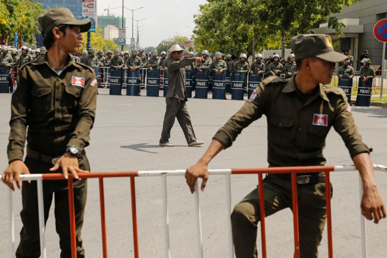 Police barricades block protestors from walking along Sothearos Boulevard during a May Day protest today in Phnom Penh.