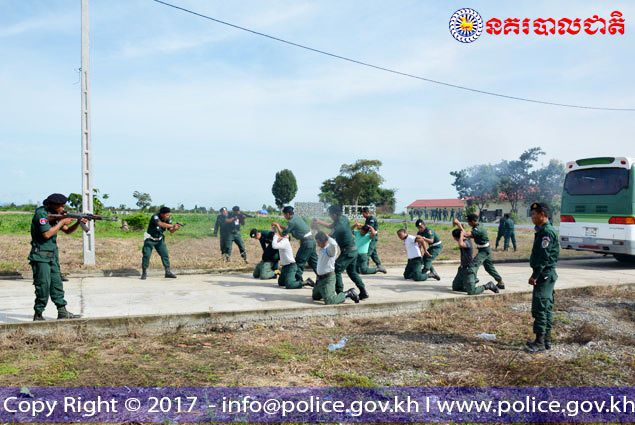 "Authorities detain mock ""protesters"" at gunpoint during a recent training session in Kampong Speu province. Security officials have yet again vowed to crack down on demonstrations amid the tensest political situation in years."