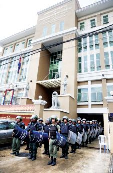 Military personnel in riot gear secure the entrance to Phnom Penh Municipal Court