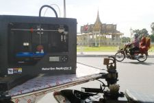 A 3D printer passes the Royal Palace in a tuk-tuk. PHOTO SUPPLIED