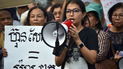 Bou Rachana, the wife of murdered Cambodian analyst Kem Ley, speaks as Australian Cambodians gather to protest against Prime Minister Hun Sen at the Asean summit Sydney at the weekend. Police are investigating a death threat made against her and her sons, as well as Victorian state MP Hong Lim. Peter Parks/AFP