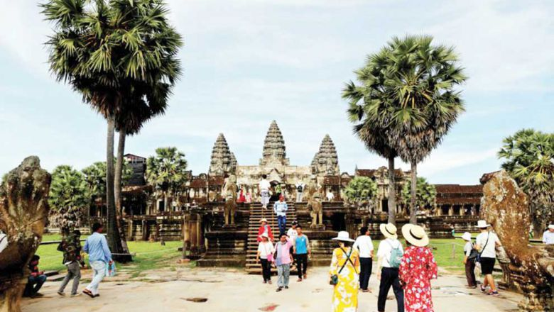 Tourists explore the Angkor Wat temple earlier this year in Siem Reap province.