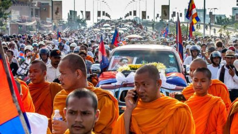 Thousands join Kem Ley's funeral procession in Phnom Penh in July 2016. During a visit to Australia, Prime Minister Hun Sen accused the CNRP and US of being behind the revered analyst's murder.