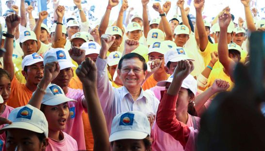 Acting CNRP leader Kem Sokha stands with supporters at the party's headquarters in Phnom Penh yesterday. Facebook