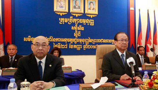 Constitutional Council head Im Chhum Lim marks the 24th anniversary of the Constitution yesterday.