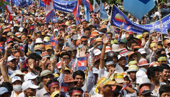 Thousands of CNRP supporters march during mass demonstrations in Phnom Penh in October