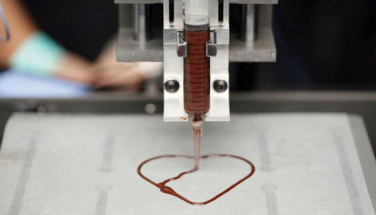 A 3D printer produces a chocolate heart. BLOOMBERG