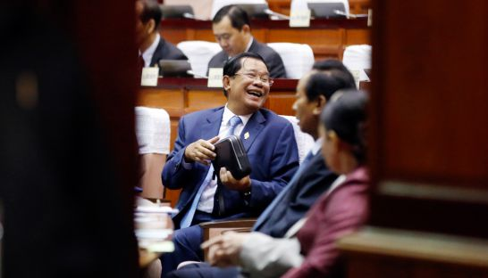 Prime Minister Hun Sen shares a laugh with lawmakers at a session of parliament in February that approved controversial changes to the Law on Political Parties.