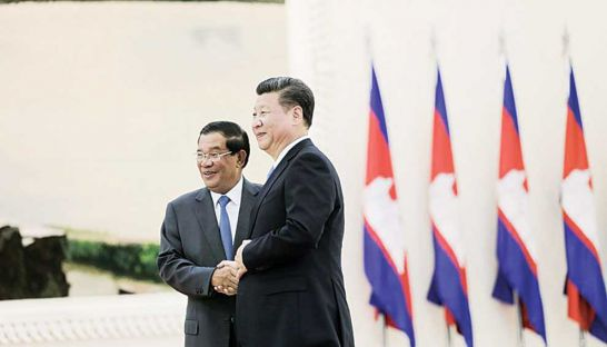 Xi Jinping, president of China and the Communist Party, and Prime Minister Hun Sen shake hands in October last year at the Peace Palace in Phnom Penh.