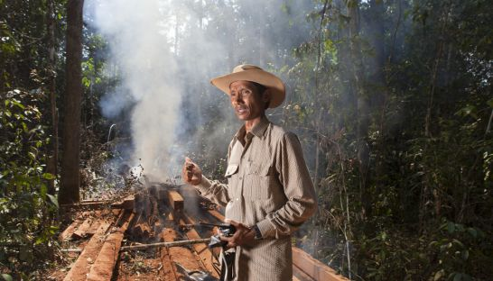 Chut Wutty, an environmental activist who was killed in Koh Kong, burns luxury wood felled by illegal loggers in the Prey Lang forest in 2012. Mathieu Young